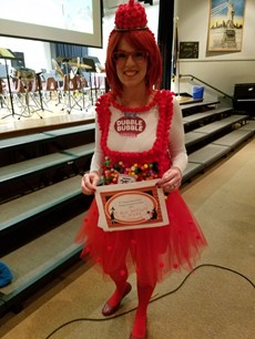 Teacher in a Double Bubble costume with pink tutu and wig