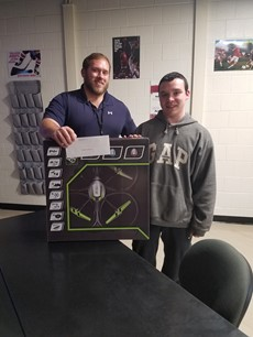 Ben Amorese and Codey Anderson with the RC Quadcopter Drone box on a table in a classroom