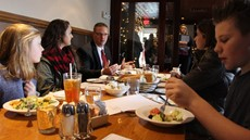 Jason Andrews, Larissa Balachick and Lizzie Hopkins sit on the left side of a restaurant table while Nora Drexler, Haley Kohlbach and Ryan Kristoff sit on the right side