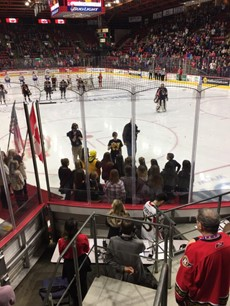 Photo of students singing before BSens game
