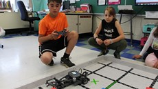 Photo of students controlling a robot