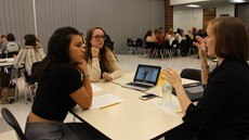Photo of students talking to professional