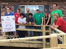 Students and teachers in front of home with new ramp