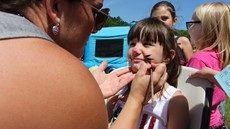 Photo of child getting her face painted