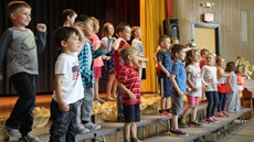 Kindergarted students on stage dancing