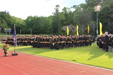 Photo of entire graduating class in caps and gowns