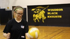 Photo of student about to serve a volleyball