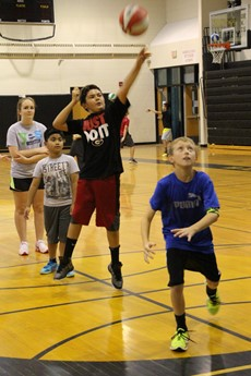 Photo of children playing basketball