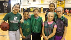 Binghamton University women's player poses for picture with Windsor basketball campers
