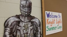 "Image of Knight in armor next to ""Welcome to Knight Lights"" sign"