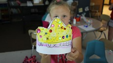 Little girl holds up a homemade crown