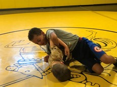 Two children wrestling