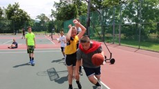 Two children playing basketball