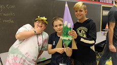 Three boys posing with their bottle rocket