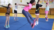girls jumping in a gymnasium