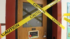 Caution tape over a door