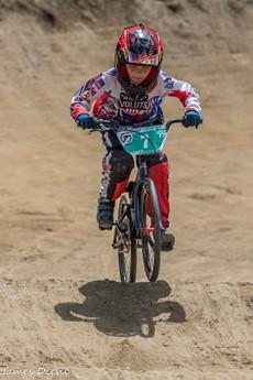 Corbin Evans riding a bmx bike in uniform and helmet