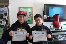 Ryan Kristof and Max DeVoe holding up certificates