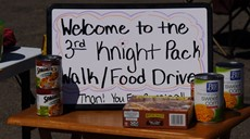 Knight Pack Walk sign on a table with food around it