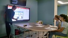 Kristen Launt, Kaitlin Pisano and Joshua Stone in a classroom