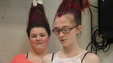 Two girls with tall, dyed red hair