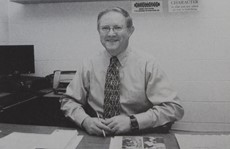 Gary Vail sitting at his desk