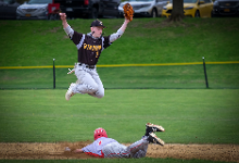 Dylan Cappello jumping while playing baseball