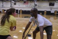 Man and girl playing basketball
