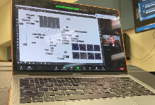 Laptop with Zoom meeting on screen