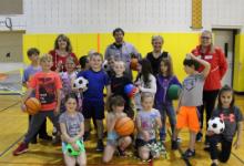 Children holding sports equipment