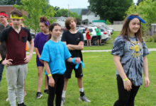 Six middle school students standing on a field