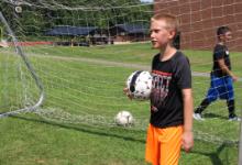 Boy holding a soccer ball