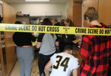 Six teenagers in a room behind crime scene tape