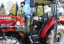 Red tractor with the door open