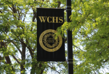 WCHS black banner on a post outside