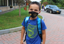 Young boy in a black facemask