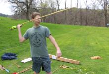 Boy holding a javelin