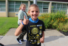 Young boy giving a thumbs up