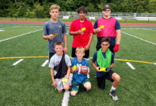 six boys on a football field