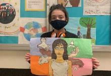 Keira Christ holding poster