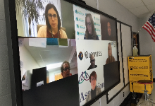 Big screen with faces from zoom call