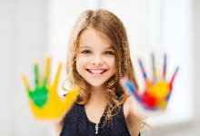 Girl with colorful paint on hands