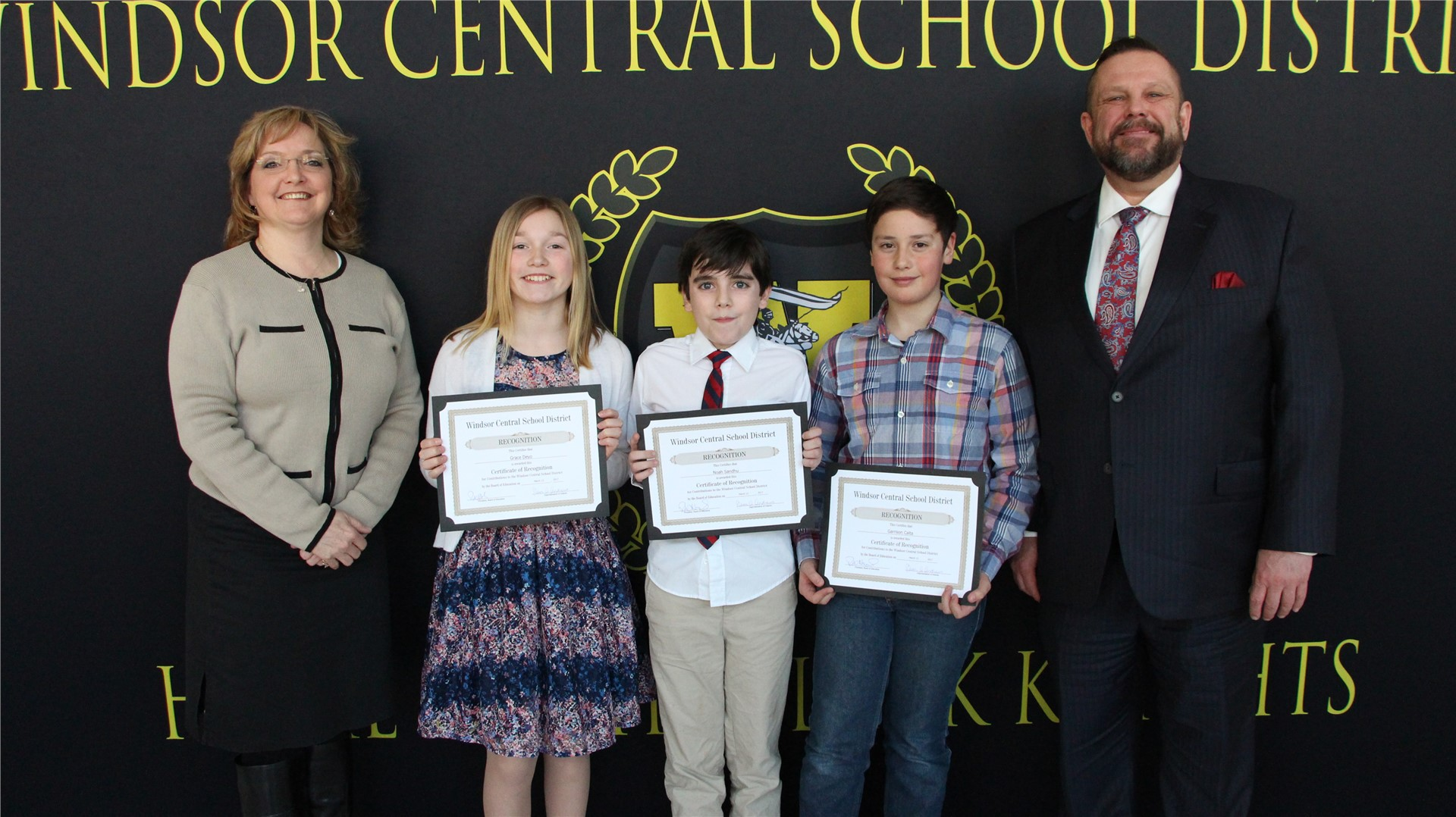 5th-grade students Garrison Calta, Grace Deyo, Sophia Chen and Noah Sandhu