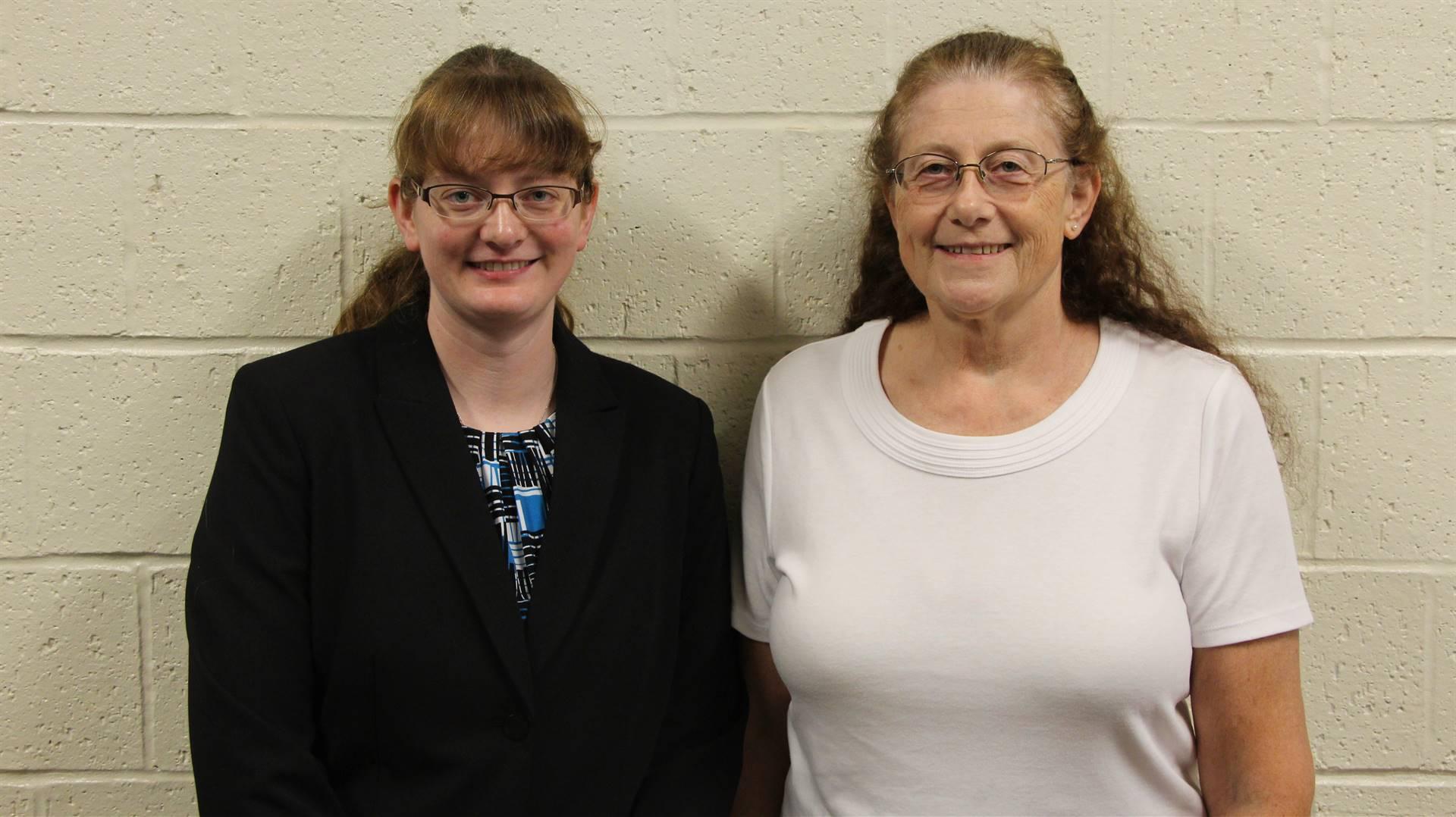 Erin G. Van Vleck standing next to a woman