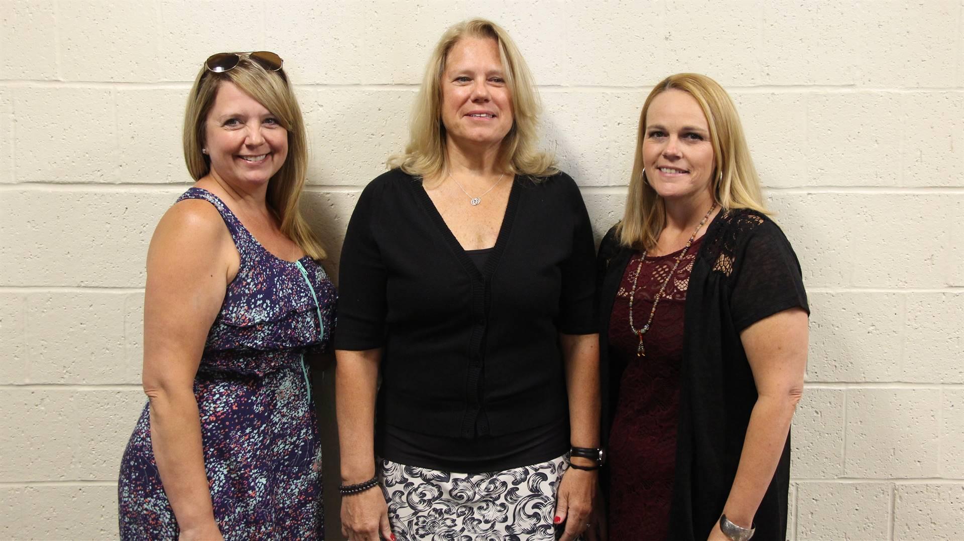 Terry Wansart standing between two other women