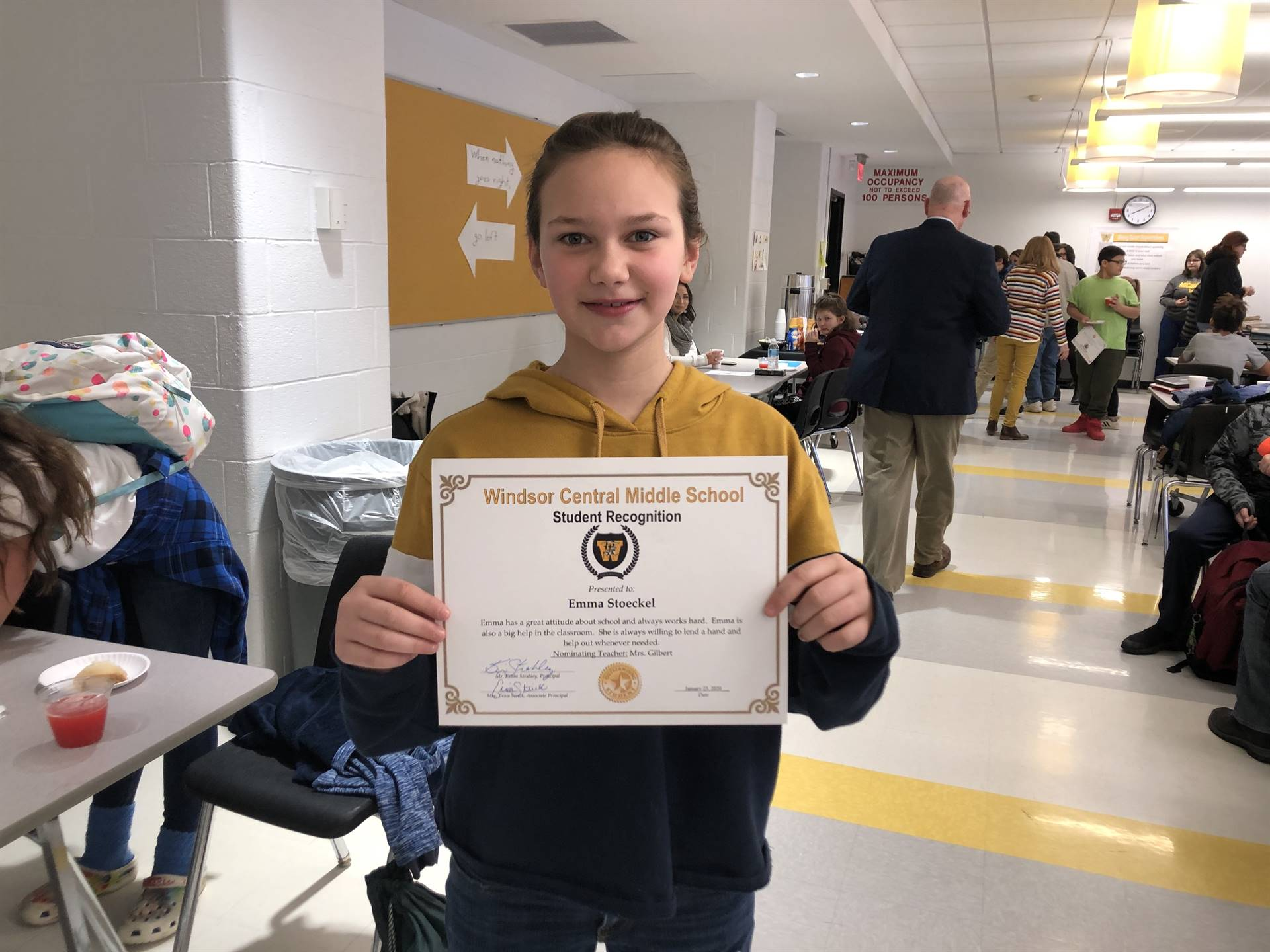 Girl holding a certificate