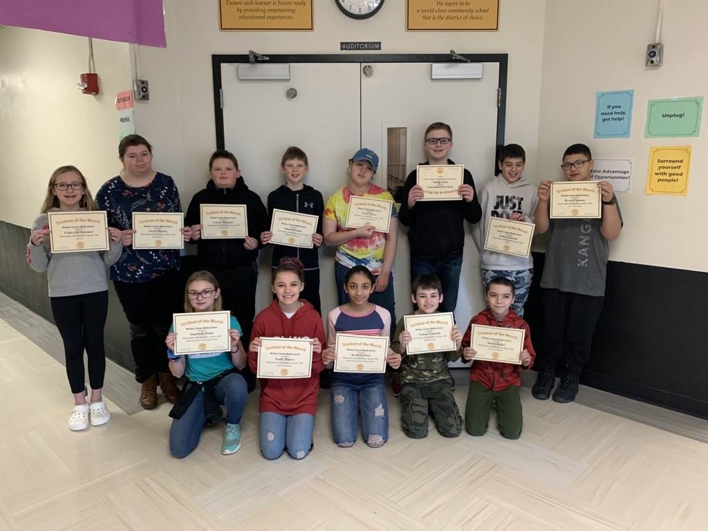 Two rows of 6th grade students holding certificates