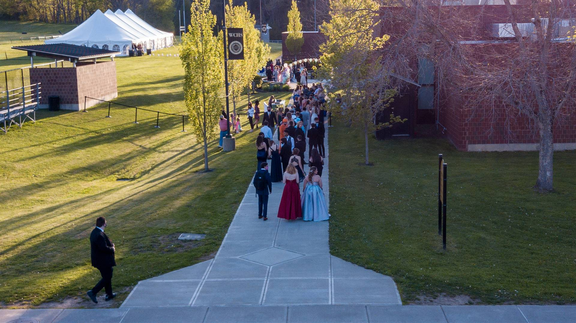 Arial view of prom goers walking outside on WCHS campus