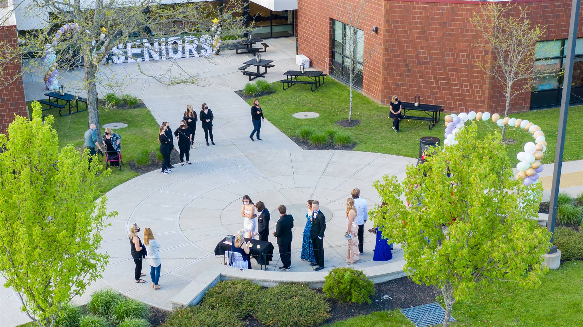 Arial view of high school with students walking