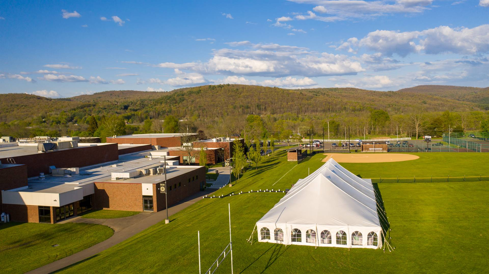 Arial view of high school and softball field with tent